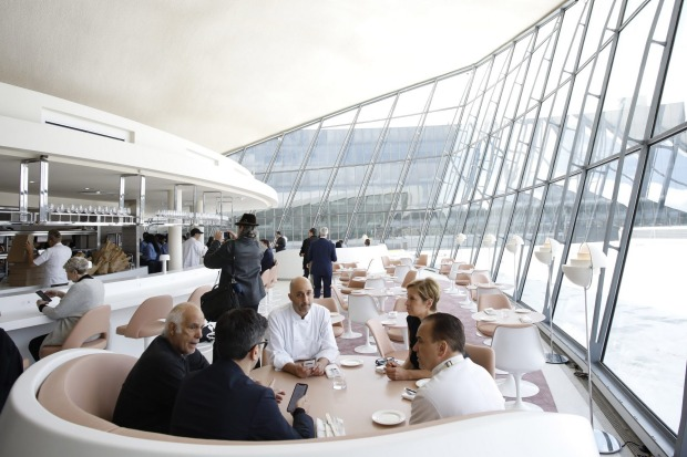 People meet in the Paris Cafe during the opening of the TWA Hotel at New York's John F. Kennedy International Airport.