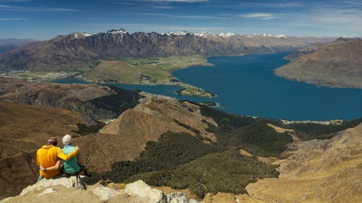 Hikers on the summit of Ben Lomond, looking over Queenstown and Lake Wakatipu.
