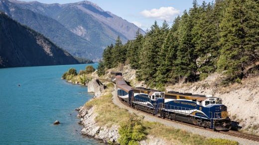 The Rocky Mountaineer train passes beside Seton Lake along the Rainforest to Goldrush route.