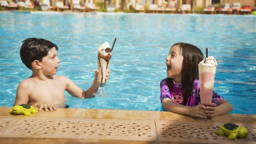 Kids enjoy mega milkshakes at the poolside cafe.