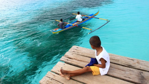 Children at Nusaniwe Beach on the island of Ambon.
