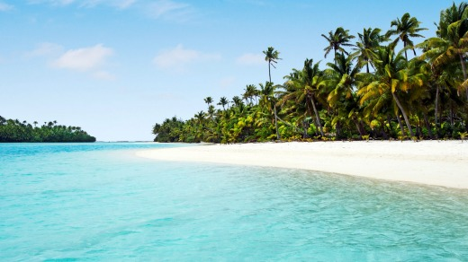 One Foot Island, in the Cook Islands, where coconut trees form a ragged fringe above pristine beaches and swirling blue ...