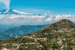 A smoking Mount Etna, as seen from the scenic mountain town of Taormina.