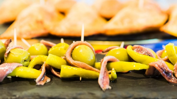 Gilda pintxos with olives are  a spicy, exotic snack found in Spain.