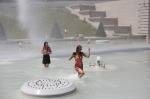 Women cool off in the fountain of the Trocadero, in Paris. More than half of France, including around Paris, was placed ...