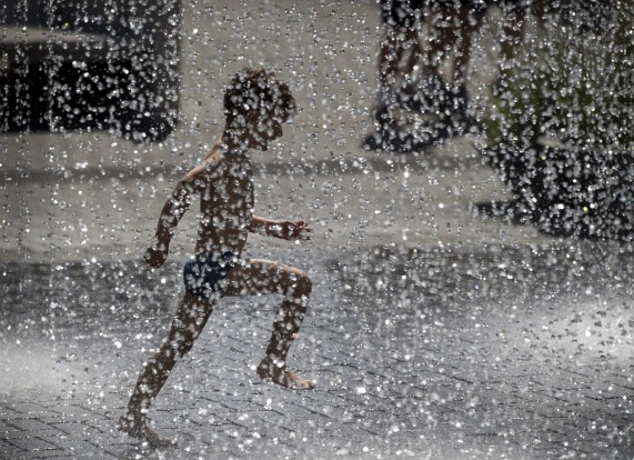 A child cools off in a public fountain in Vilnius, Lithuania.