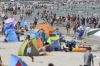 People crowd the beach at the Baltic Sea in Binz, Germany.