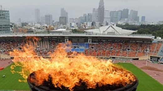 A flame is ignited at the Olympic cauldron, which was used at the 1964 Tokyo Olympics, at National Stadium in Tokyo to ...