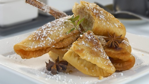 "Oviedo's famous ""casadielles'' – hot doughnuts filled with ground walnuts, almonds and anise."