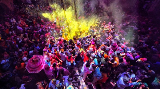 Hindu devotees seen throwing colourful powders (gulal) inside Bankey Bihari Temple of Vrindavan, India.