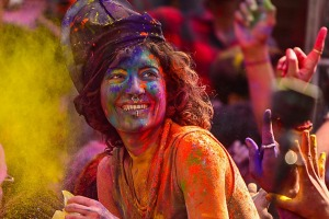 A tourist celebrates Holi with Pushkar local people.