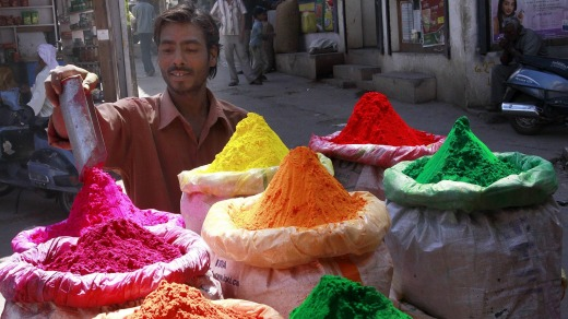 A man prepares colourful powder for sale in the market ahead of the Holi festival in Bhopal.
