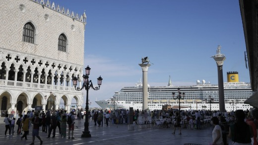 A cruise ship passes by St. Mark's Square. Locals want large ships banned from the lagoon.