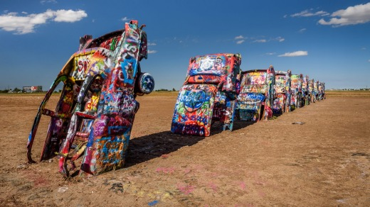 The Cadillac Ranch at Amarillo, Texas, a public art installation of old car wrecks and a popular landmark on historic ...