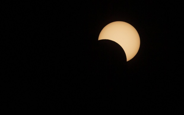 The moon passes in front of the sun during a solar eclipse in La Higuera, Chile. Tourists from around the world gathered ...