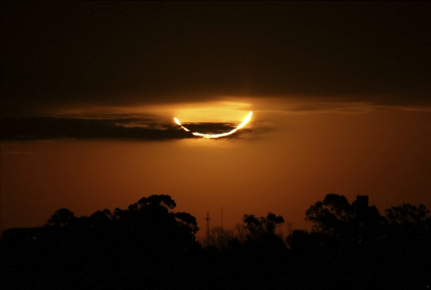 The moon blocks the sun during the total solar eclipse, seen from Buenos Aires, Argentina. Tourists from around the ...