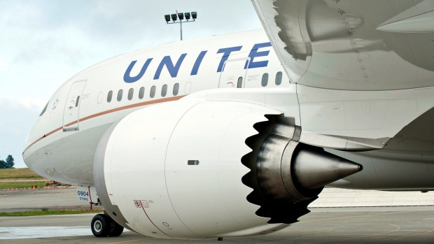 United Airlines flight diverted, man arrested after 'report of someone's  ear being bit off'