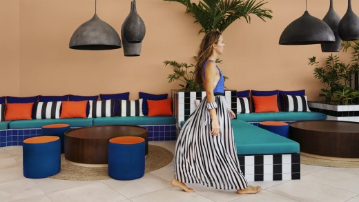 Bright tropical hues and thick black-and-white stripes appear throughout the resort.