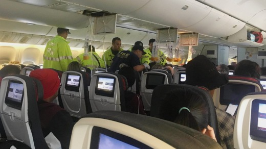 Australian band Hurricane Fall provided this photo of emergency services treating a passenger after an Air Canada flight ...