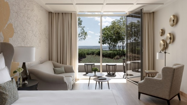 Hotel room overlooking vineyards and countryside at Royal Champagne Hotel & Spa.