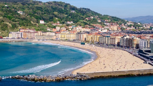 Zurriola Beach, San Sebastian, where you can hang out with friends on the rock wall and enjoy a drink.