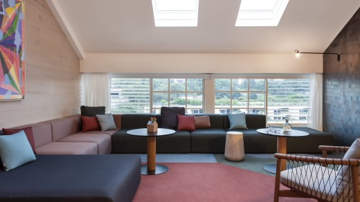 A loft suite – a split level, long room with a large living area complete with an L-shaped couch large enough to ...
