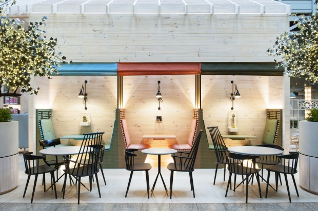 The hotel bar and restaurant, Alibi, fills the ground level space along with a games area and some booths with pull-down ...