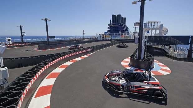 Formula for fun: Go-Karts zoom around the speedway on Norwegian Joy.