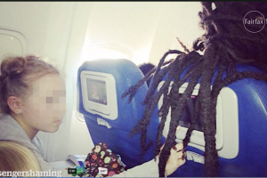 One of many passengers caught with their hair covering the inflight entertainment.