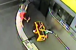 A toddler went on a wild ride through the baggage conveyor belt at an airport in the US.