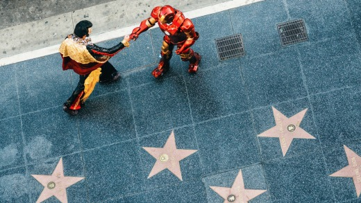 Elvis Presley and Ironman impersonators greeting each other on the Hollywood Walk of Fame.