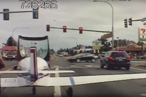 The plane pulls up neatly at a set of traffic lights.