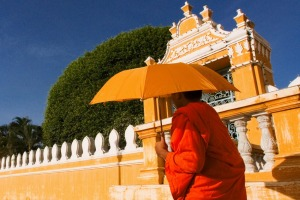 A monk walks outside Phnom Penh's Royal Palace.