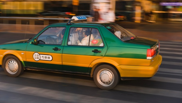 Be cautious when exchanging cash with taxi drivers in Beijing.
