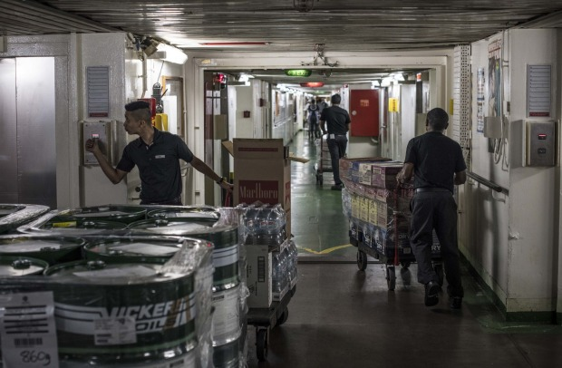 Produce is loaded and organised on board P&O Pacific Explorer.