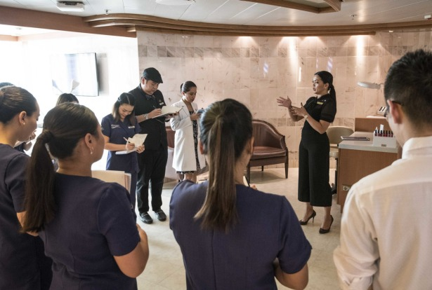Spa staff meet early to plan the day on board P&O Pacific Explorer.