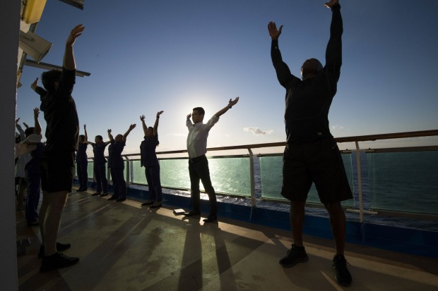 Spa staff meet early to plan the day and stretch, on board P&O Pacific Explorer.