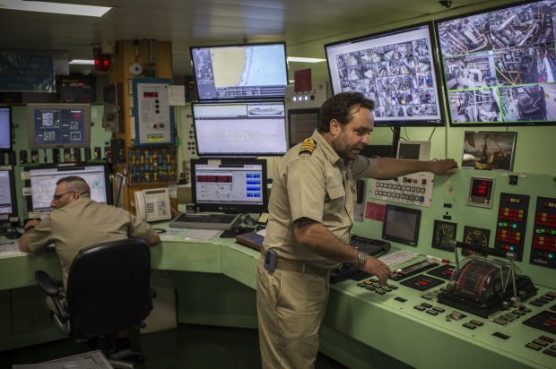 Engineers working in the engine control room on board P&O Pacific Explorer.