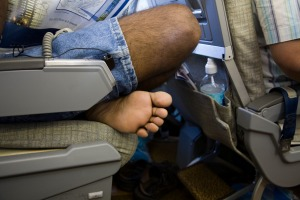 An economy passenger makes himself at home.