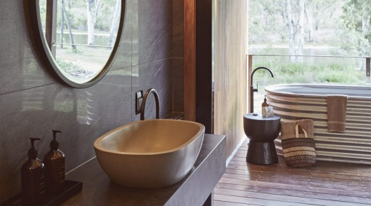 All rooms come with a private outdoor bathtub, fashioned from corrugated iron.