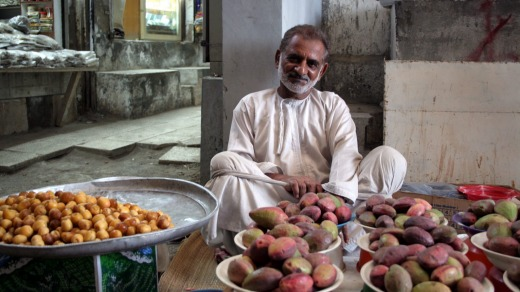 A fruit seller in the Old Mutrah Souq.