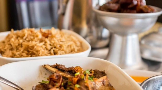 Shuwa is a traditional Omani dish where meat is marinated in spices, wrapped in palm or banana leaves and then cooked ...
