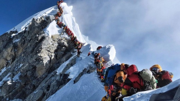 In the same week that seven climbers died on Everest, mountaineer Nirmal Purja's photo showing crowds of climbers ...