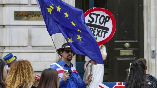 Anti-Brexit protesters demonstrate outside the Cabinet Office in Whitehall in London.