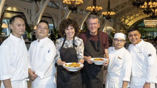 Job done: Jill Dupleix and Terry Durack with some of the kitchen team at The Fullerton, Singapore.