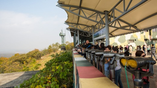 Tourists look into Noprth Korea from Dorasan lookout on the border.