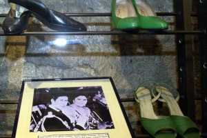 A photo of the former First Lady Imelda Marcos with Prince Charles, alongside some of her incredible collection of shoes.