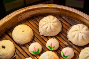Asian dumplings, or dim sum, cooking in a wooden steamer in Yokohama's Chinatown, near Tokyo.