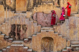 Indian women carrying water from a stepwell.