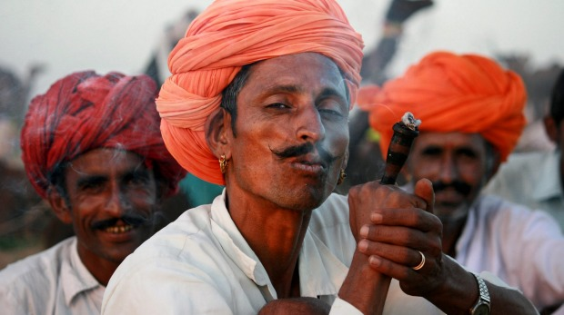 Rajasthani camel drivers smoking chillum.